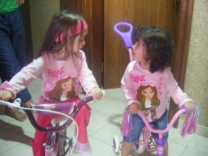 Janah & Serene had enough space to bike ride in the hallway of our new apartment